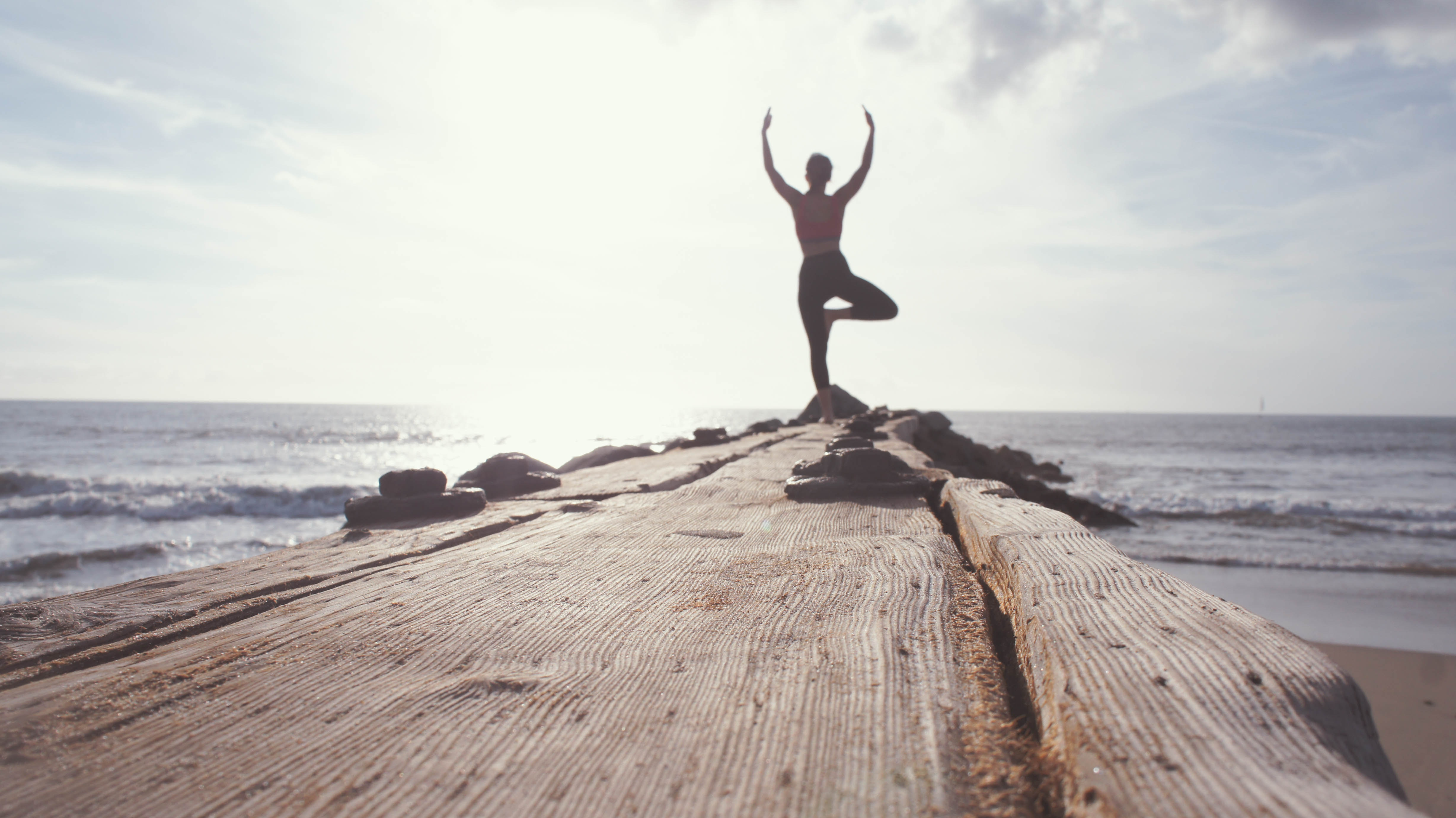 Healthcare expert exercising by the ocean.