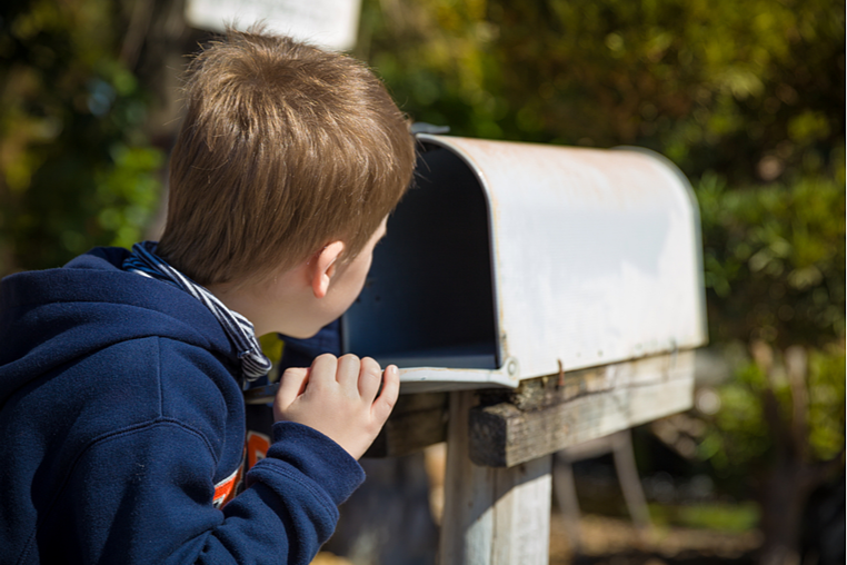 Boy looking for direct mail